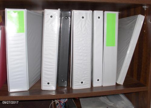 Shelf full of 3-ring Binders