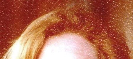 Color of this redhead's hair at age 41